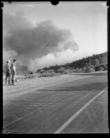 Men observe smoke from the National Forest Inn fire, California, 1932