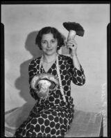 Mary Fiesel poses with gigantic mushrooms for the Los Angeles Times, Los Angeles, (1930-1935?)