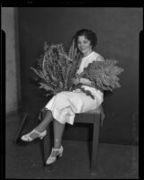 Mary Fiesel poses with wildflowers for the Los Angeles Times, Los Angeles, (1930-1935?)