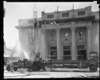 Firefighters attend the fire destroying the First Baptist Church of Hollywood, Hollywood, 1935