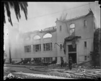 Firefighters after the fire destroying the First Baptist Church of Hollywood, Hollywood, 1935