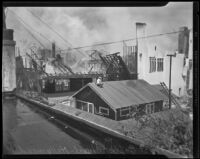 Man on roof observes First Baptist Church of Hollywood ablaze, Hollywood, 1935
