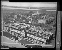 Copy negative of an aerial photograph of the proposed Firestone factory, Los Angeles, 1927