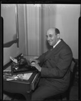 Dr. Morris Fishbein typewriting an article, likely at the Biltmore, Los Angeles, 1935