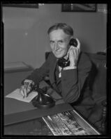 Harvey S. Firestone seated and holding telephone receiver, Los Angeles, 1935