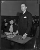 Buron Fitts and sister, Berthal Gregory, in court during perjury trial, Los Angeles, 1934