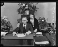 Buron Fitts and wife Marion Fitts in his office, Los Angeles, 1927-1939