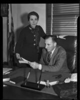 District Attorney Buron Fitts and his sister/secretary Mrs. Berthal Gregory looking at letters, Los Angeles, 1928-1939