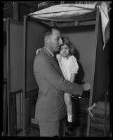 Buron Fitts and daughter voting at polling station, Los Angeles, 1929-1933