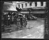Flooded intersection of 7th and Broadway during torrential rainstorm, Los Angeles, 1926