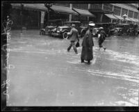 Flooded intersection of 8th and Broadway during torrential rainstorm, Los Angeles, 1926