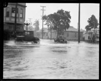 Intersection flooded during rainstorm, [Los Angeles County?], 1926