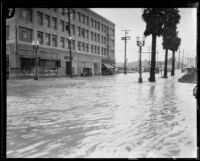Rain-flooded commercial district at 6th and Kenmore, Los Angeles, 1927