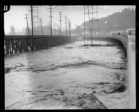 Glendale bridge destroyed by a storm flooding in the Los Angeles River, Los Angeles, 1927