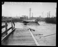 Glendale bridge destroyed by storm flooding in the Los Angeles River, Los Angeles, 1927