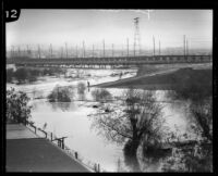 Pacific Electric Railway (or Red Car Trolley) bridge during rainstorm flooding in the Los Angeles River, Los Angeles, 1927