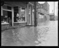 Rain-flooded commercial street, Compton, 1927