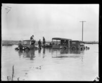 Automobiles in flood water at 11th and Vernon Avenues, los Angeles, 1927