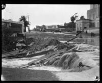 Rainstorm flooding on Wilshire Blvd. in front of the Wilshire Christian Church, Los Angeles, 1927