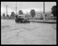 Automobile at flooded intersection of Yosemite Dr. and Eagle Rock Blvd. in Eagle Rock, Los Angeles, 1929