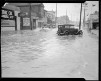 Storm-flooded street in a commercial area, [Los Angeles County?], 1933