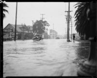 Rain-flooded city street, [Los Angeles County?], 1933