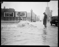 Overflowing manhole on rain-flooded city street, [Los Angeles County?], 1933