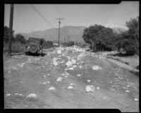 Rock-and-mud-strewn road after a devastating flood and mudslide, La Crescenta-Montrose, 1934