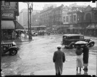Flooded intersection of 1st St. and Broadway during a rainstorm, Los Angeles, [1926?]
