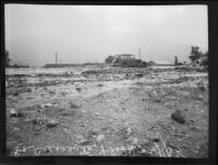 Two automobiles on a road littered with flood debris, La Crescenta-Montrose, 1935