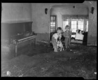 Two boys and a dog inside their flood-damaged house, La Crescenta-Montrose, 1934