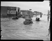 Storm-flooded Beverly Blvd. at the intersection with Lake St., Los Angeles, circa 1927-1939