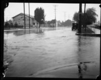 Storm-flooded intersection of 47th and Figueroa, Los Angeles, [circa 1927-1939]
