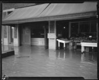 Produce store on a flooded street during or after a rainstorm, Los Angeles County, 1927