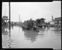 Commercial street flooded during or after a heavy rainstorm, Los Angeles County, 1927