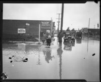 Slauson and Second Avenue flooded during or after a heavy rainstorm, Los Angeles, 1927