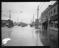 Commercial street flooded during or after a rainstorm, [Los Angeles County?], 1927