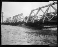 Center street bridge spanning the San Gabriel River swollen with rainstorm flooding, Los Angeles County, 1927