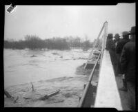 San Gabriel River from the Norwalk Street bridge during rainstorm flooding, [Norwalk?], 1927