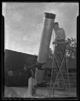 E. G. Richardson beside the telescope that he constructed for Whittier College, Whittier, 1947