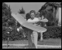 Frank Uecker holds a model plane for the Times-Richfield-Jimmie Allen model building contest, Glendale, 1935
