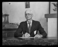 Samuel T. S. Doncyson, businessman, seated at a desk, Montebello, 1935