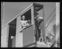Lorraine Geise and  H. W. Miller in a steam shovel cab on the first day of flood control work, La Crescenta-Montrose, 1935