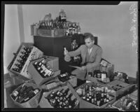 Robert Brown of the liquor control division checks cases of seized liquor in the California State Building, Los Angeles, 1935