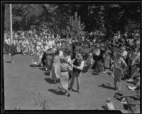 Couples country dancing at the annual Iowa Association picnic at Bixby Park, Long Beach, 1935