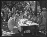 Picnickers at the Iowa Golden Wedding Club table at the annual Iowa Association picnic at Bixby Park, Long Beach, 1935