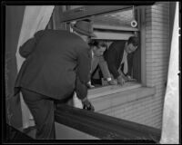 Detectives Thad Brown and George Hill and another man investigate Fred La Mar's accidental fall at the Hotel Rosslyn, Los Angeles, 1935