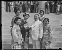 Miss Lil Tokio Alice Watanabe extends an invitation to Mayor Frank L. Shaw for the Nisei festival, Los Angeles, 1935