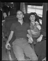 Ann Bagot and her son, Robert, starting deportation journey on a train at Southern Pacific Station, Los Angeles, 1935