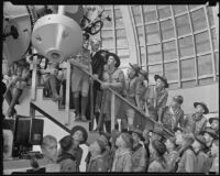 Dinsmore Alter shows a group of Arizona Boy Scouts the Zeiss refracting telescope at the Griffith Observatory, Los Angeles, 1935
